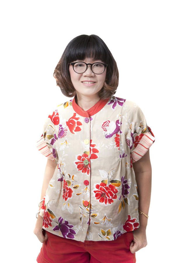 Feche acima de uma face de quarenta anos de glasse vestindo dos olhos da mulher asiática idosa fotografia de stock royalty free