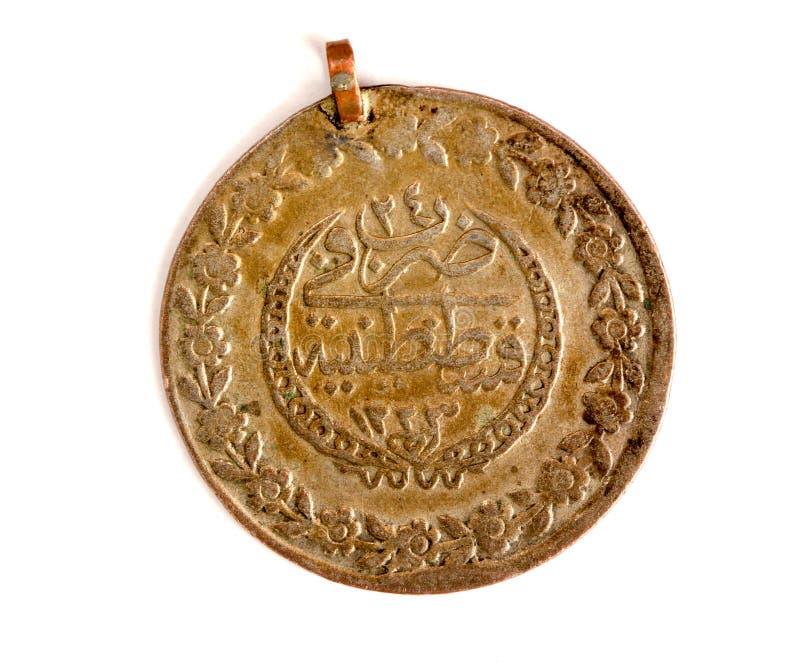 feche acima de uma moeda antiga do otomano fotos de stock