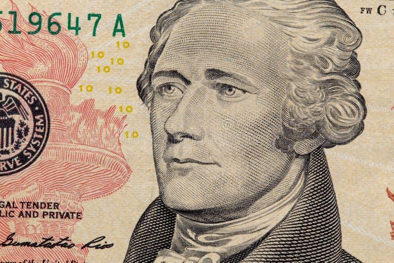 Feche acima de uma nota de dólar dez Dólares do fundo Dólares americanos do dinheiro do dinheiro dez fanfarrões Retrato de Alexan foto de stock royalty free