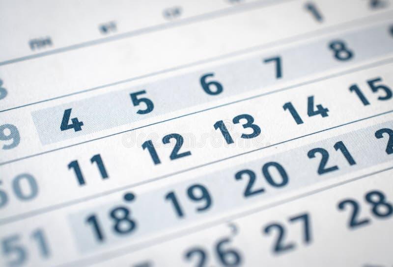 Feche acima do calendário onze do negócio, doze, treze traduzem: mês de dezembro imagem de stock