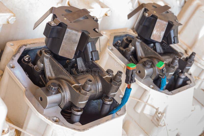 Feche acima do componente de motor do compressor do impulsionador do gás, do eixo de came e da entrada, retentor da válvula de ex imagem de stock