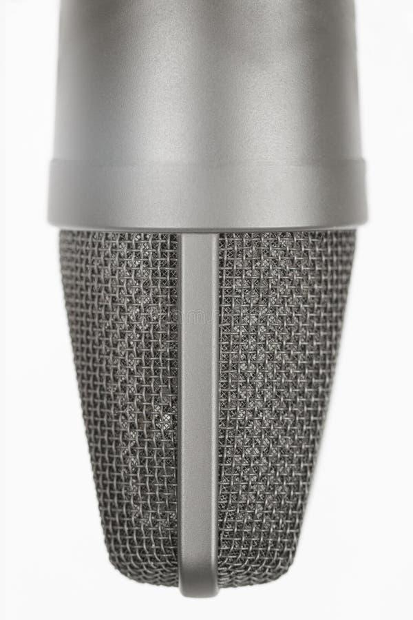 Feche acima do detalhe de cabeça do microfone fotografia de stock royalty free