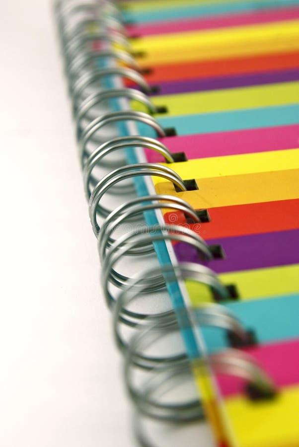Feche acima do emperramento espiral do caderno colorido fotografia de stock royalty free