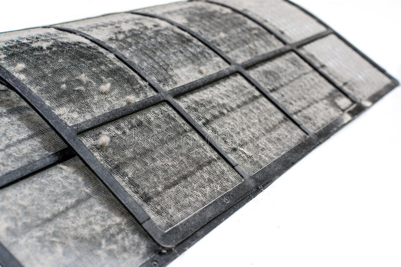 Feche acima do filtro sujo do condicionador de ar foto de stock