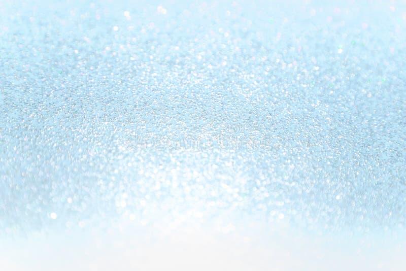 Feche acima do fundo macio do sumário do bokeh do brilho do papel azul fotos de stock royalty free