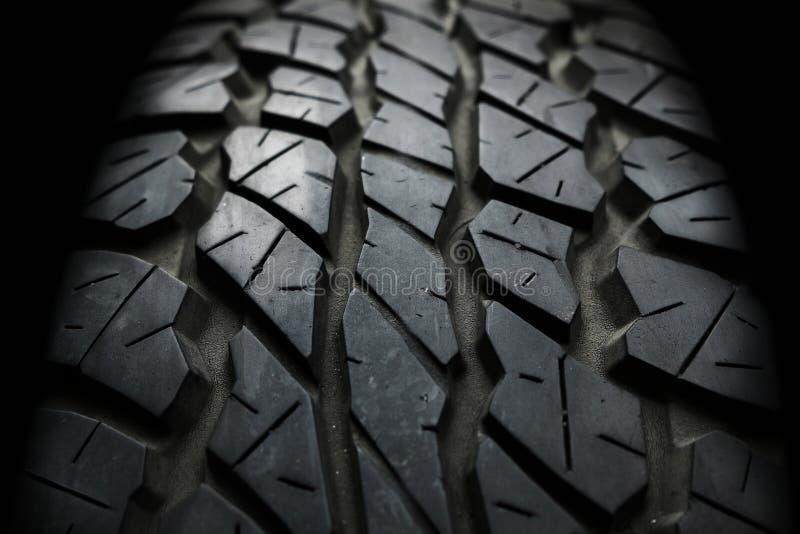 Feche acima do fundo velho e usado da textura do pneumático do veículo fotografia de stock royalty free