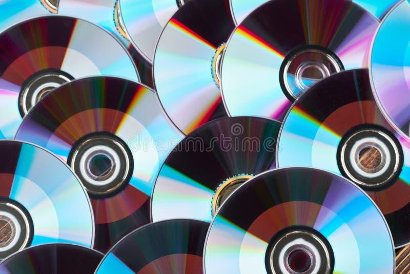 Feche acima do grupo de discos de DVD imagem de stock