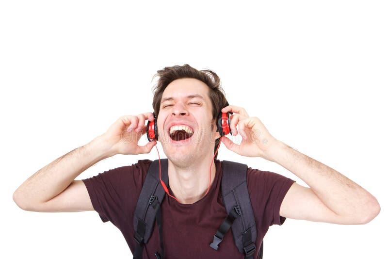 Feche acima do indivíduo fresco com fones de ouvido que escuta a música alta fotografia de stock royalty free