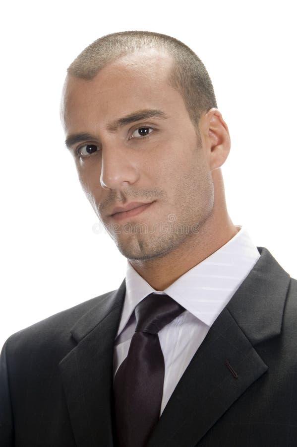 Feche acima do pose do homem de negócios novo imagens de stock