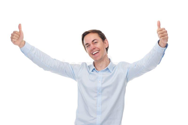 Feche acima do retrato de um homem feliz que sorri com polegares acima fotos de stock royalty free