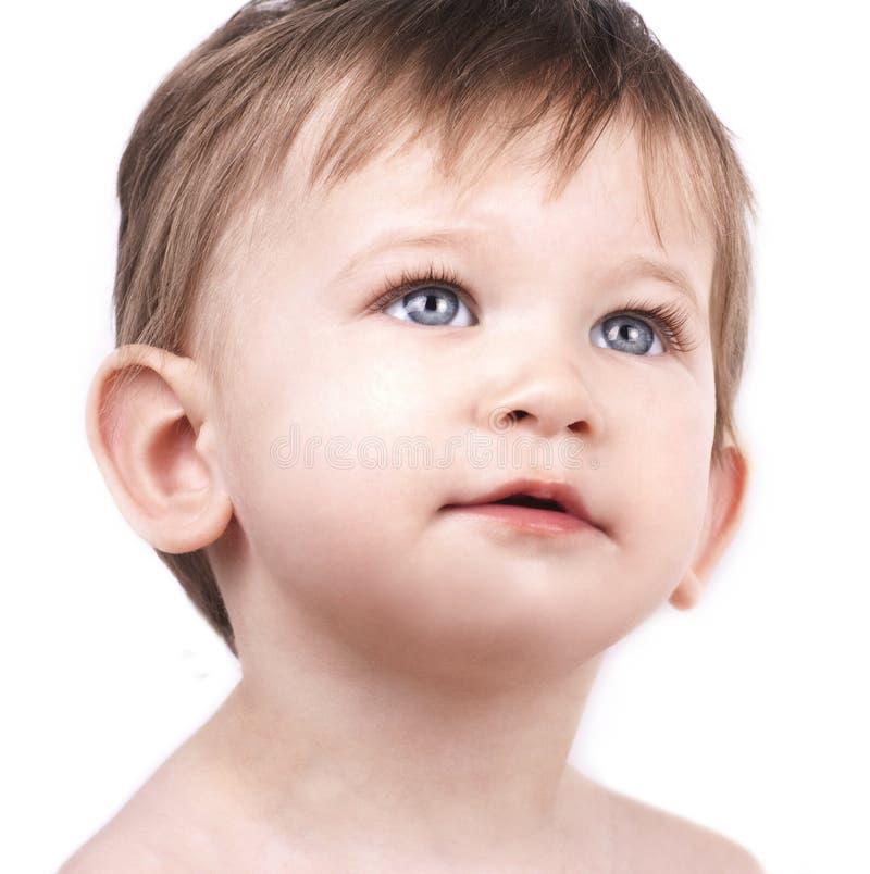 Feche acima do retrato do rapaz pequeno bonito imagens de stock