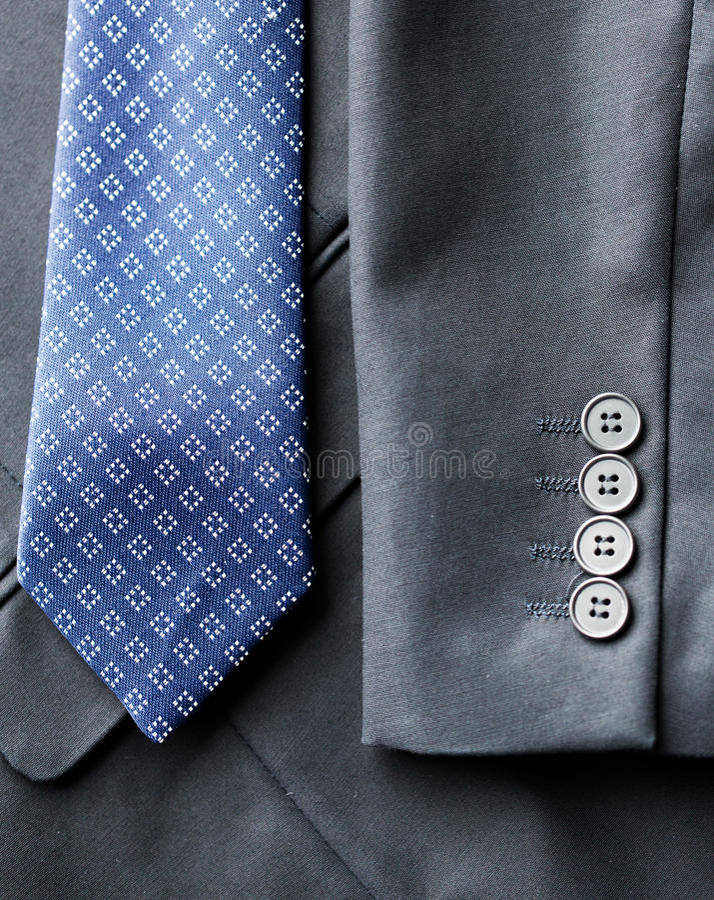 Feche acima do revestimento do terno de negócio e amarre fotos de stock