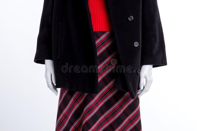 Feche acima do revestimento preto e da saia modelada fotografia de stock