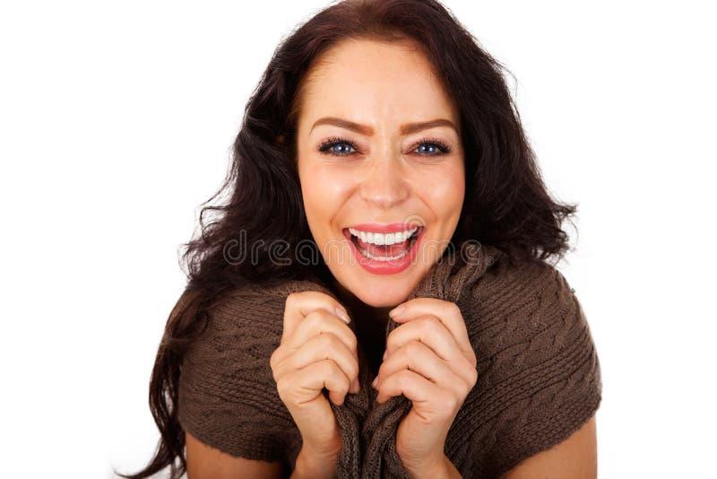 Feche acima do riso atrativo de uma mulher mais idosa imagem de stock