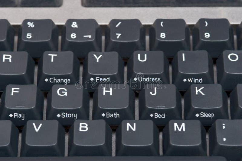 Feche acima do teclado de computador com teclas do bebê fotografia de stock