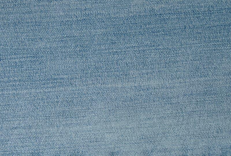 Feche acima do teste padrão do fundo da sarja de Nimes azul Jean Texture fotos de stock royalty free