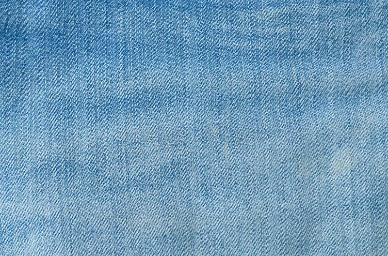 Feche acima do teste padrão do fundo da sarja de Nimes azul Jean Texture foto de stock royalty free