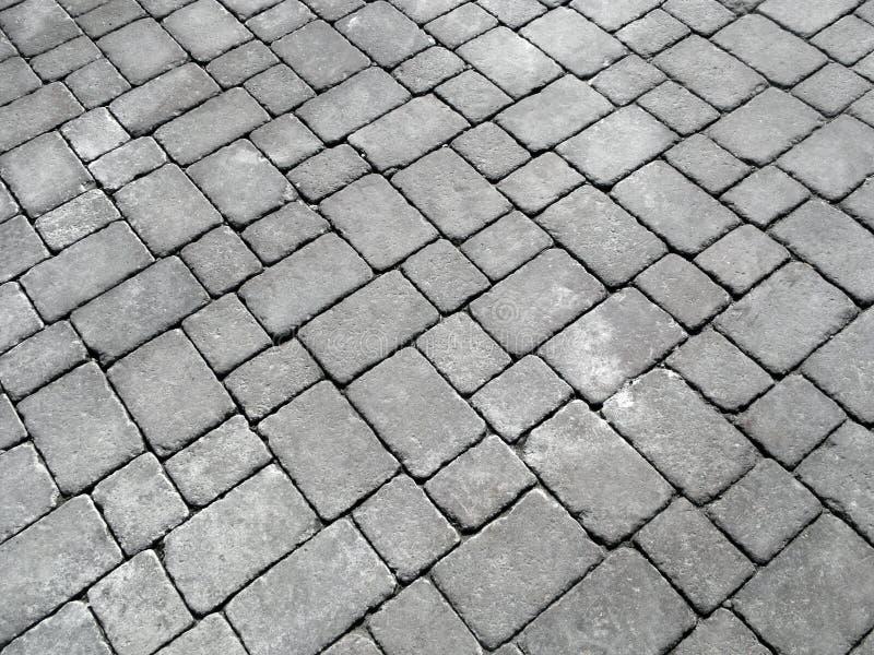 Feche acima dos cobblestones em uma estrada inglesa velha. foto de stock