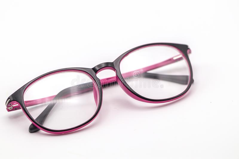 Feche acima dos vidros pretos e cor-de-rosa do olho no fundo branco fotos de stock royalty free