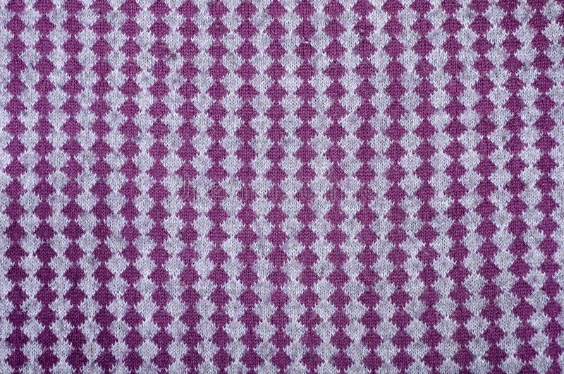 Feche acima na textura vertical da tela de lã da malha fotografia de stock
