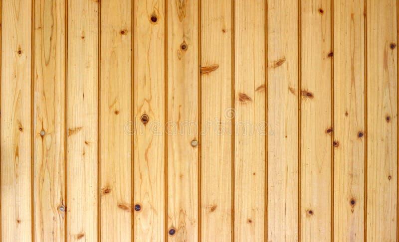 Feche acima no fundo marrom dos painéis da madeira fotos de stock royalty free