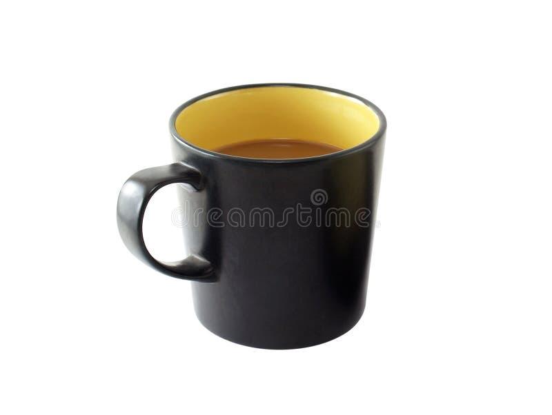 Feche acima o café do leite no copo de café preto isolado no fundo branco foto de stock royalty free