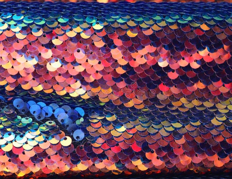 Feche acima a superfície de matérias têxteis e de telas bonitas e coloridas da forma foto de stock royalty free