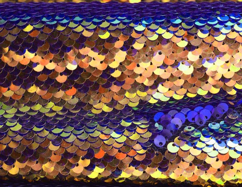 Feche acima a superfície de matérias têxteis e de telas bonitas e coloridas da forma fotografia de stock