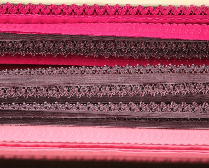 Feche acima a superfície de matérias têxteis e de telas bonitas e coloridas da forma imagens de stock royalty free