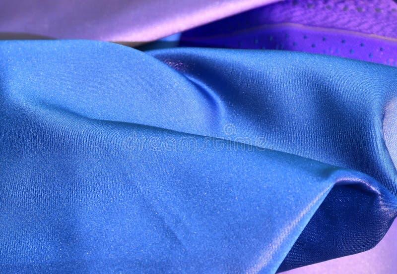 Feche acima a superfície de matérias têxteis e de telas bonitas e coloridas da forma imagem de stock