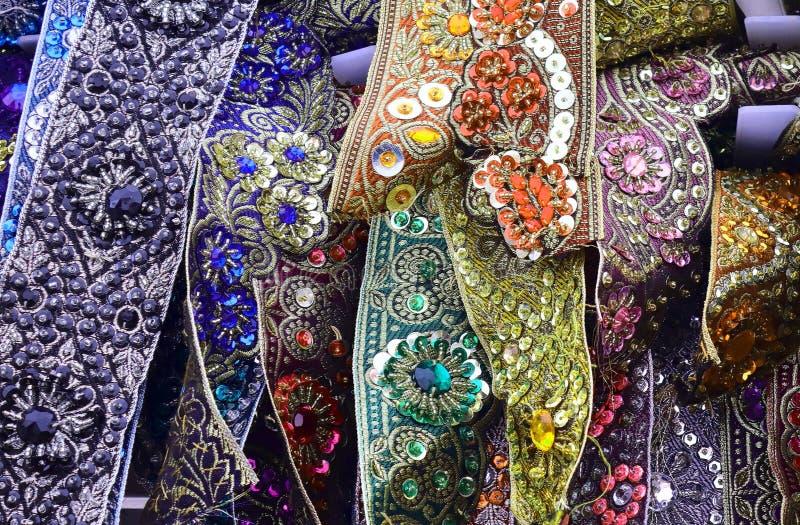 Feche acima a superfície de matérias têxteis e de telas bonitas e coloridas da forma fotografia de stock royalty free