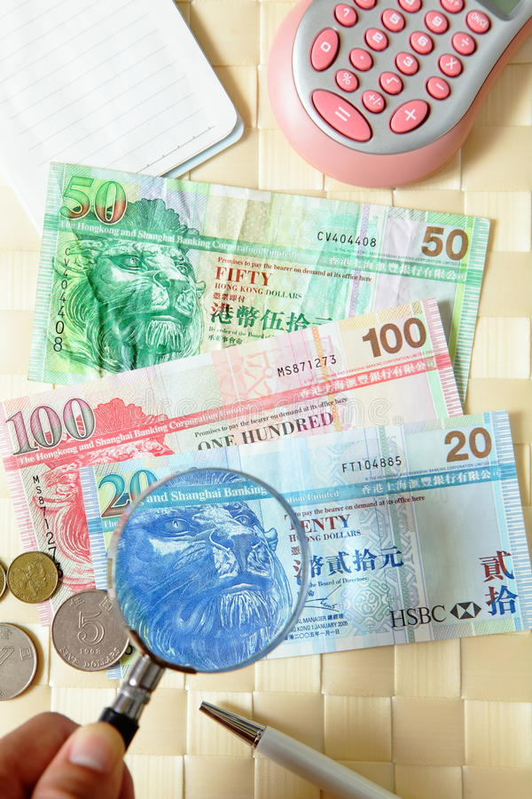 Feche o dinheiro de Hong Kong da vista com vidros do olho imagens de stock