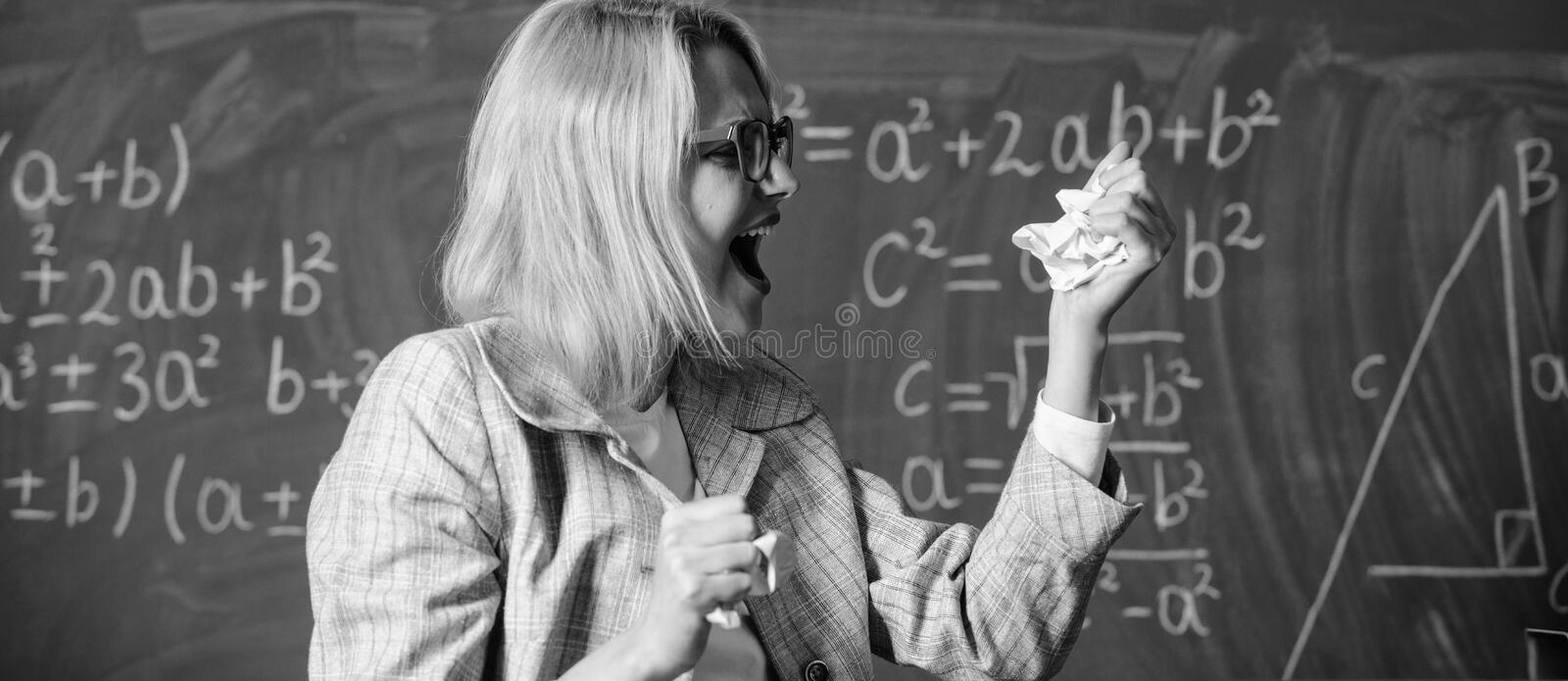 Fed up of fails. Trial and error is fundamental method of problem solving. Teacher screaming face holds pieces of paper. With mistakes wrongly solved test royalty free stock images