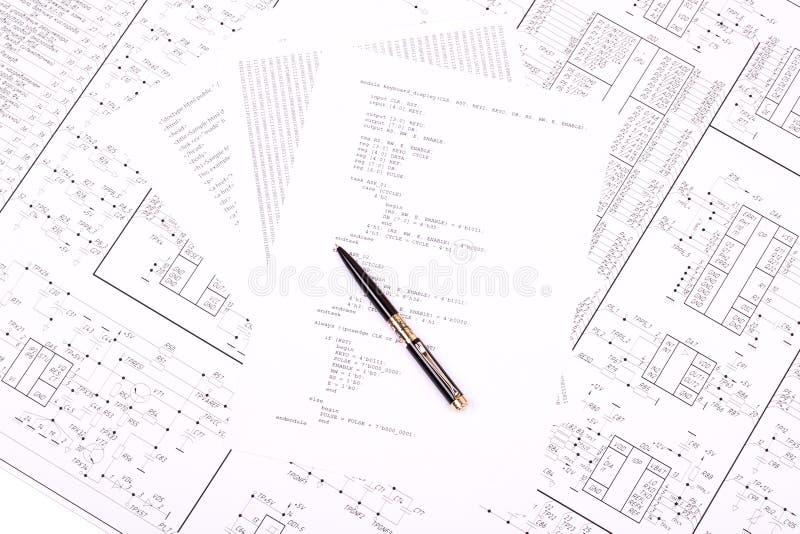Feder auf Papier mit dem Programm stockbild