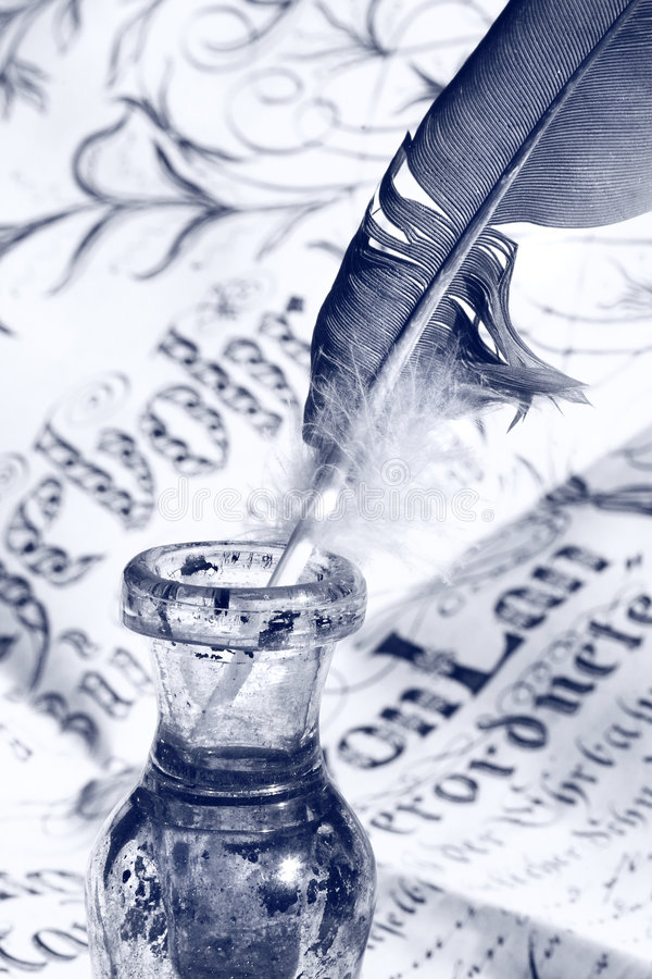 Feder im Tintenfaß stockfoto