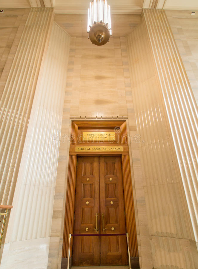 Federal Court of Canada. The entrance door to the Federal Court of Canada next to parliament hill in Ottawa, Ontario, Canada stock photo