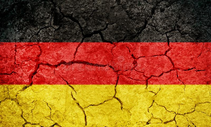 Federal Republic of Germany flag. On dry earth ground texture background stock image