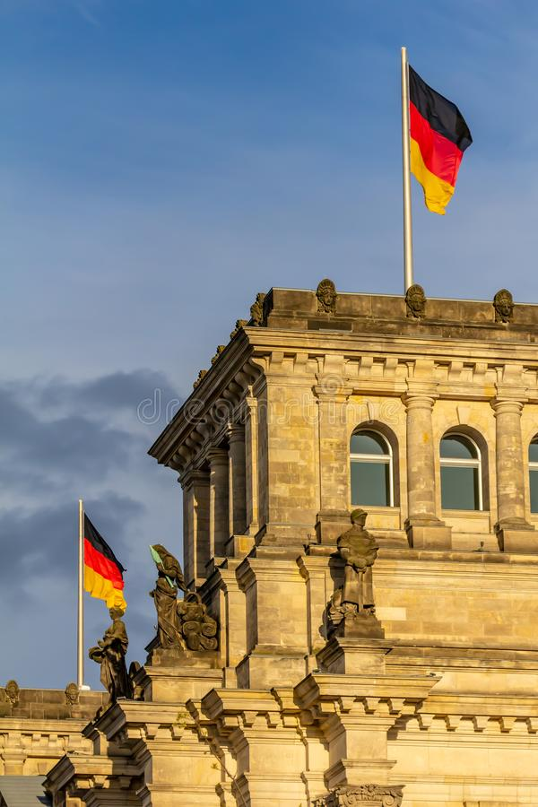 Federal Republic of Germany, German national flag. At the Parliament building waving on the blue sky background stock photography