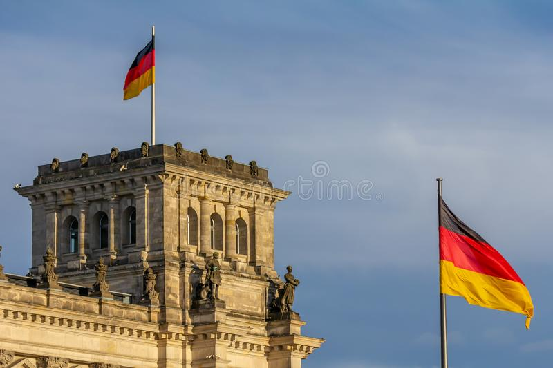 Federal Republic of Germany, German national flag. At the Parliament building waving on the blue sky background stock image
