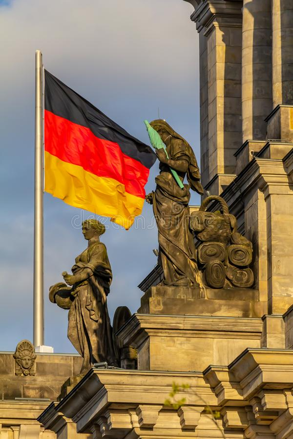 Federal Republic of Germany, German national flag. At the Parliament building waving on the blue sky background stock photos