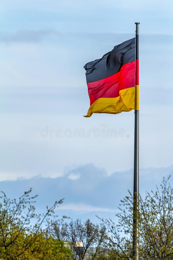 Federal Republic of Germany, German national flag. Waving on the blue sky background royalty free stock photography