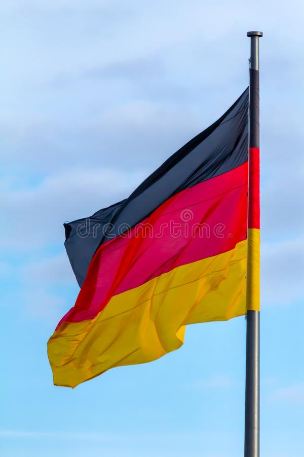 Federal Republic of Germany, German national flag. Waving on the blue sky background stock images