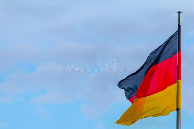 Federal Republic of Germany, German national flag. Waving on the blue sky background stock image