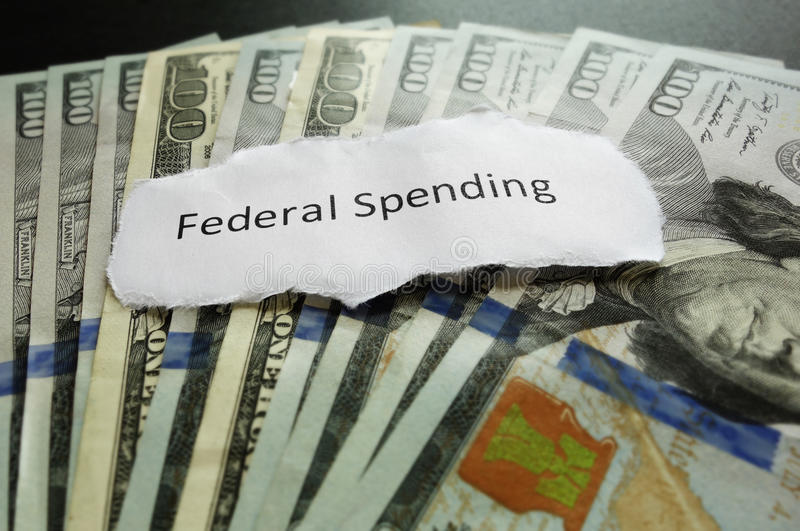 Federal Spending. Paper text on assorted cash royalty free stock photo