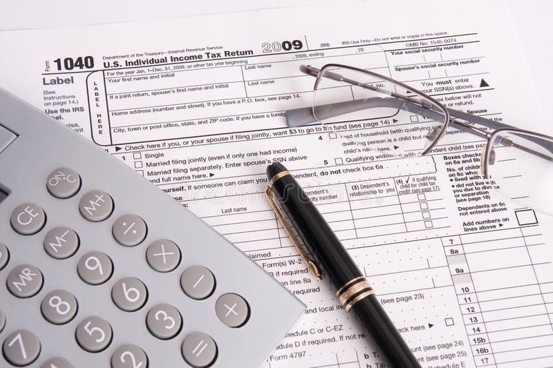 Download Federal Tax Form Calculator And Pen Royalty Free Stock Photography - Image: 14228367