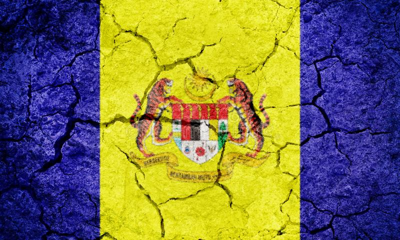 Federal Territory of Putrajaya, planned city of Malaysia, flag. On dry earth ground texture background stock photography