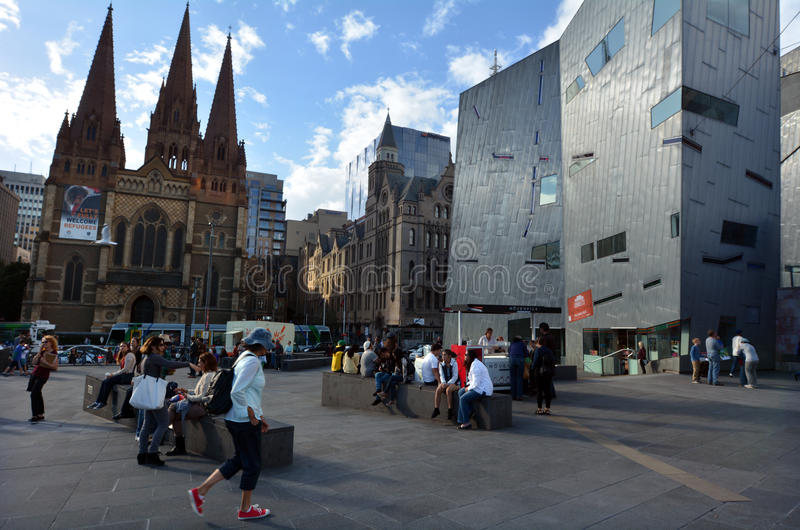 Federation Square - Melbourne. MELBOURNE - APR 13 2014:Visitors at the Federation Square.It located at the heart of Melbourne�s CBD with size of an entire royalty free stock images