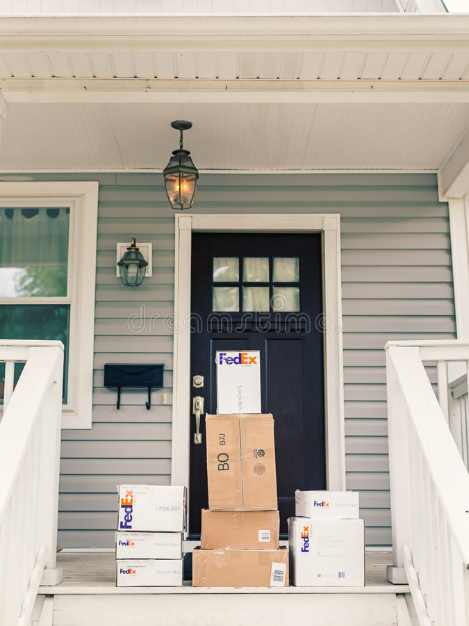Free FedEx Boxes On Front Porch Royalty Free Stock Photos - 60164678
