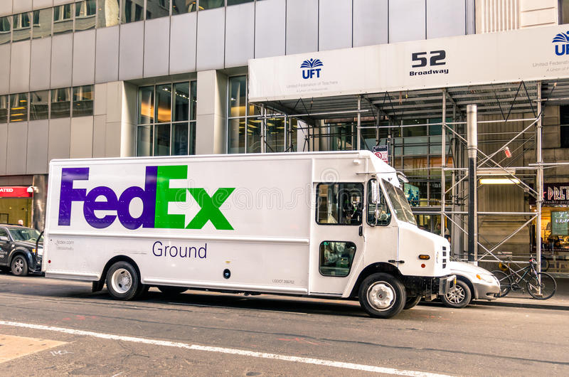 FedEx van delivering in downtown Manhattan. NEW YORK CITY - NOVEMBER 21, 2013: FedEx van delivering in downtown Manhattan. The name FedEx is the short version of stock photos