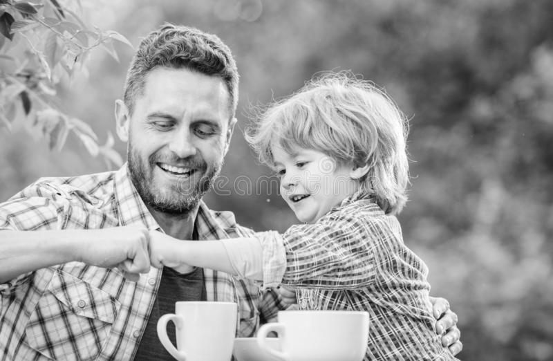 Feed baby. Natural nutrition concept. Fathers day. Best friends. Father and son having fun. Feeding son natural foods. Healthy food. Father and boy drink tea royalty free stock photo